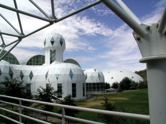 Scientific Illustration of Biosphere 2 - a photograph of the facility as it was in 2003, 20 years after the experiment.